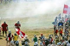 Battle of Grunwald reenactment. GRUNWALD - July 18: Clash in smoke, Polish, Lithuanian and other Knights vs Teutonic Knights at -Battle of Grunwald 1410 y Royalty Free Stock Photo