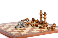 Battle with a gun on a chess board Stock Images