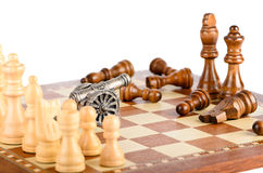 Battle with a gun on a chess board Royalty Free Stock Photo