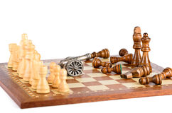 Battle with a gun on a chess board Stock Image
