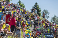 Battle in Jura Mountains - Tour de France 2016. Col du Grand Colombier,France - July 17, 2016: The cyclists Majka and Zakarin riding through a crowd of Royalty Free Stock Images