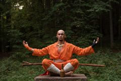 Battle monk in orange clothes royalty free stock images