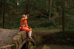 Battle monk in orange clothes stock photos