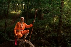Battle monk in orange clothes stock photography