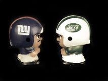 Battle of New York,  Li`l Teammates Toy Figures. Battle of New York, New York Giants v. New York Jets, Li`l Teammates Toy figures on a black backdrop Stock Photos