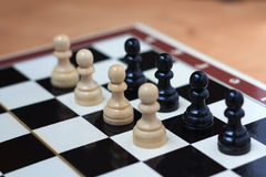 Battle of pawns on the chessboard Stock Images