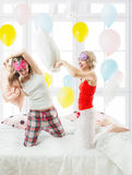 Battle on the pillows. Royalty Free Stock Photo