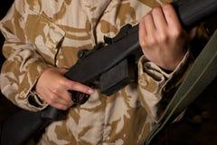 Battle rifle camouflage Royalty Free Stock Image