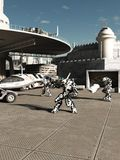 Battle Robots at the Spaceport. Science fiction illustration of battle robots ready to attack or defend the spaceport in a future city, 3d digitally rendered Stock Image