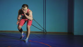 Battle ropes exercise in the gym slow mo stock video footage