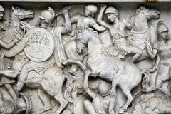 Battle scene below River god (Arno) statue Royalty Free Stock Images