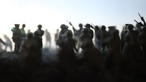 Battle scene. Military silhouettes fighting scene on war fog sky background. World War Soldiers Silhouettes Below Cloudy Skyline. At sunset. Artwork Decoration stock video