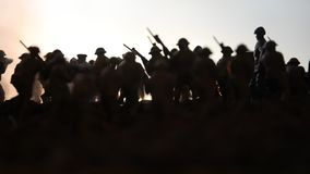 Battle scene. Military silhouettes fighting scene on war fog sky background. World War Soldiers Silhouettes Below Cloudy Skyline. At sunset. Artwork Decoration stock footage