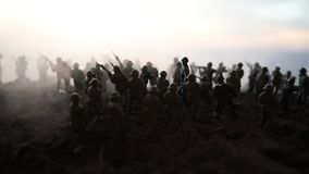 Battle scene. Military silhouettes fighting scene on war fog sky background. World War Soldiers Silhouettes Below Cloudy Skyline. At sunset. Artwork Decoration stock video footage