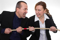 Battle of the Sexes. Businessman and businesswoman fighting with a rope Royalty Free Stock Photography