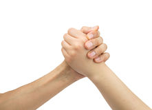 Battle of the sexes. Two hands of one man and one woman in arm wrestling with white background as concept fight between sexes Stock Images