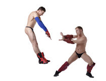 Battle of sexual strippers in superheroes costumes Stock Image