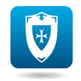 Battle shield with ornament icon, simple style. Battle shield with ornament icon in simple style in blue square. Weapon for war symbol Royalty Free Stock Photography