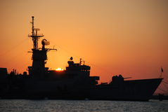 Battle ship. Seeming a battle ship at sunset Royalty Free Stock Image