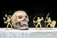 Battle skeleton with human skull in night time, still life style royalty free stock photography