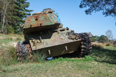 Battle tank in a moor between two forests Royalty Free Stock Photo