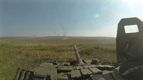 Battle tank riding and firing POV, POVD stock video