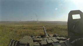 Battle tank riding and firing POV, POVD. Battle tank riding and firing on batllefield POV, POVD stock video