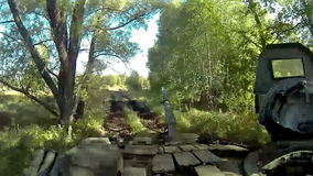 Battle tank riding and firing POV, POVD. Battle tank riding and firing on batllefield POV, POVD stock video footage