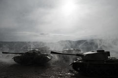 Battle Tanks moving in the desert in fog. War scene decoration. Soldiers Royalty Free Stock Photography