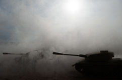 Battle Tanks moving in the desert in fog. War scene decoration. Soldiers Stock Image