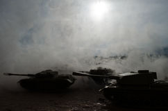 Battle Tanks moving in the desert in fog. War scene decoration. Soldiers Stock Photography