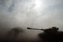 Battle Tanks moving in the desert in fog. War scene decoration. Soldiers Stock Photos