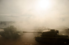 Battle Tanks moving in the desert in fog. War scene decoration. Soldiers Stock Photo