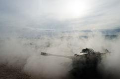 Battle Tanks moving in the desert in fog. War scene decoration. Soldiers Stock Images