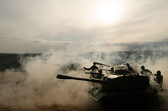Battle Tanks moving in the desert in fog. War scene decoration. Soldiers Royalty Free Stock Image