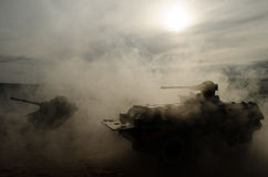 Battle Tanks moving in the desert in fog. War scene decoration. Soldiers Royalty Free Stock Photos