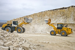 Battle between two giant diggers Stock Photos
