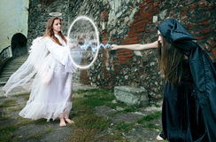 Battle between the witch and an angel Royalty Free Stock Photos