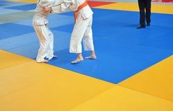 Battle young judo athletes Royalty Free Stock Image