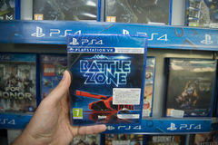 Battle zone VR. Bratislava, Slovakia, circa april 2017: Man holding Battle zone VR videogame on Sony Playstation 4 console in store Stock Photo