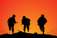 Battlefield. Silhouette of three soldiers on the battlefield Royalty Free Stock Image