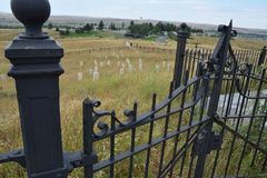 Little Bighorn battlefield markers from iron gate. Battlefield markers at Little Bighorn Monument from the position of the iron gate and fence that now royalty free stock photo