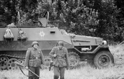 Battlefield soldiers and armoured vehicle with black and white Royalty Free Stock Image