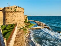 Castello Aragonese castle of Taranto. Apulia, Italy. Battlement of Castello Aragonese castle of Taranto at sunset. Apulia, Italy Stock Photos