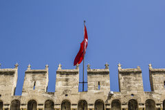 Battlements of the ancient walls of Topkapi Palace. And the Turkish flag Royalty Free Stock Image