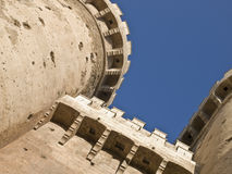 Battlements of a Castle. Battlements of the towers of a medieval castle viewed from below Royalty Free Stock Images