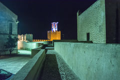 Battlements, pathways and towers of Badajoz muslim wall at night Royalty Free Stock Image