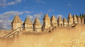 Battlemetns of the moorish Gibralfaro castle, Malaga, Spain. Battlemetns of the moorish Gibralfaro castle on a sunny day with blue sky, Malaga, Spain Stock Photos