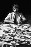 Battles of restaurateurs. Handsome man eats at table. Battles of restaurateurs. Handsome man or sexy muscular macho athlete in unbutton shirt eats with fork and Royalty Free Stock Photo