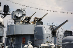 Battleship guns. View of main guns on an old battleship. Fletcher-class destroyer stock photos